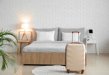 Suitcase In Modern Hotel Room