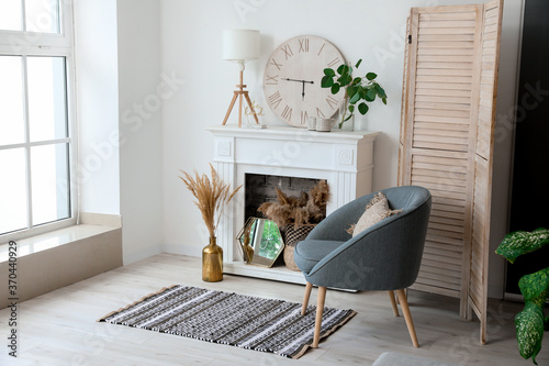Obraz Stylish fireplace in interior of living room - fototapety do salonu