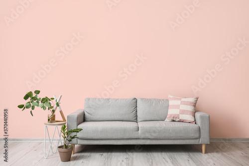 Fotografie, Tablou Sofa near wall in interior of living room