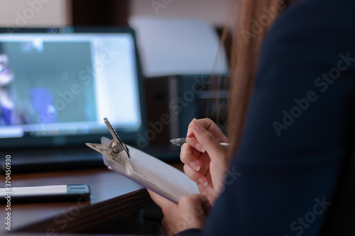 Writing notes in an online therapy with a psychologist Slika na platnu
