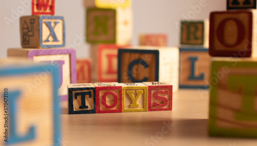 Photo Word Toys written with wooden blocks