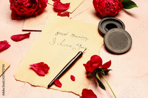 Vintage letter with fountain pen on color background