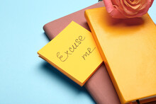 Notebooks And Papers With Text EXCUSE ME On Color Background