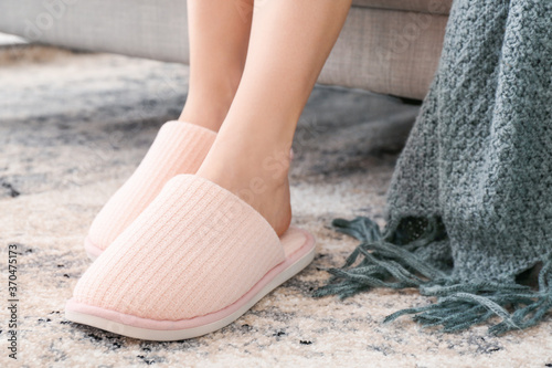 Obraz Young woman in soft slippers at home - fototapety do salonu
