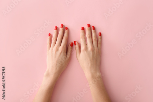 Obraz Hands with beautiful manicure on color background - fototapety do salonu