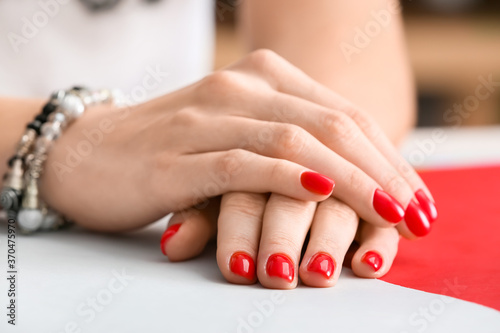 Obraz Hands with beautiful manicure on color background, closeup - fototapety do salonu