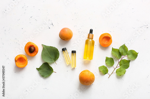 Bottles of apricot essential oil on white background Canvas Print