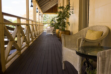 Old Queenslander Style Verandah With Cane Chairs