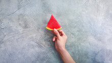 Woman's Hand Holding A Piece O...