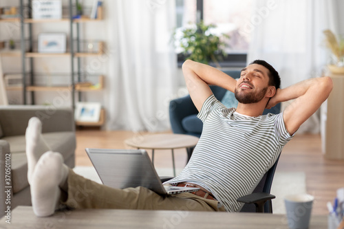 Slika na platnu remote job and business concept - happy smiling man with laptop computer resting