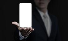 Business Man Holding Smartphon...