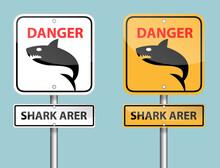 White And Orange Danger Shark Area Sign Pole On Blue Background