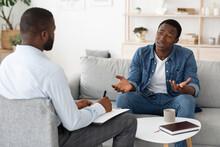 Stressed Black Man Explaining ...