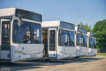 Four New Buses Standing In The Line