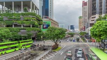 Traffic With Cars On A Street And Urban Scene In The Central District Of Singapore Aerial Timelapse. Eu Tong Sen Street. Downtown Skyscrapers Around