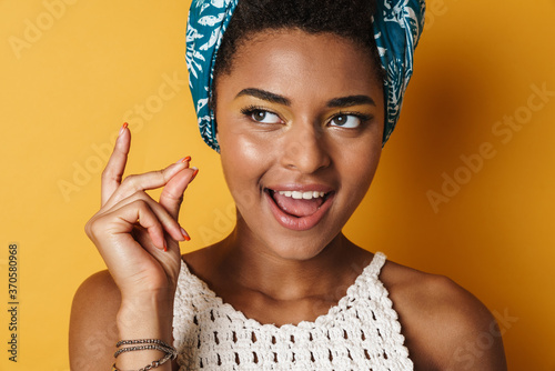 Photo Image of funny african american woman snapping her fingers and laughing
