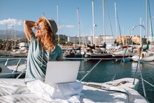 Beautiful Young Woman Work With Laptop Computer In Alternative Office Boat At The Dock - Happy Alternative People Enjoying Smart Working Job Activity - Pretty Female Use Computer In Summer Time