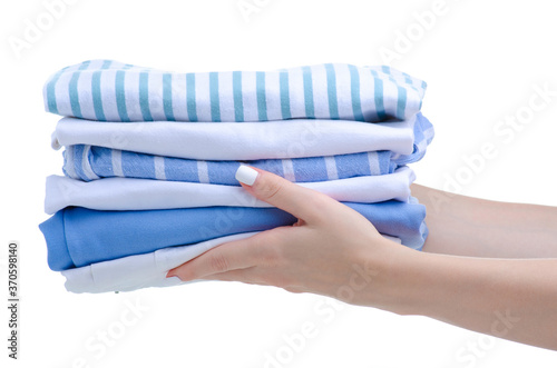 Fotografering Stack folded cloth white blue in hand on white background isolation