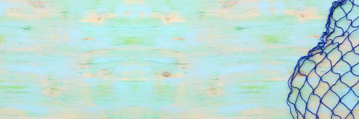 Top view of Fishnet on pastel blue wooden background. top view, flat lay