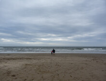 Father And Son, Walking In The Sand To The Horizon (far)