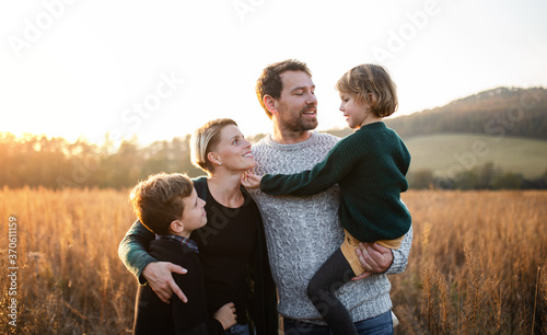Leinwand Poster Beautiful young family with small children on a walk in autumn nature