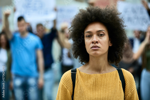 Portrait of young African American woman on a protest for black civil rights Wallpaper Mural