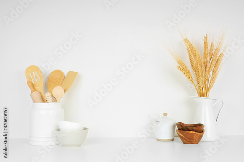 Kitchenware and utensils on a white shelf or counter against a white wall background with copy space Tapéta, Fotótapéta