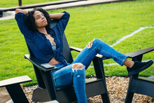 Black Woman Relaxing In Chair ...