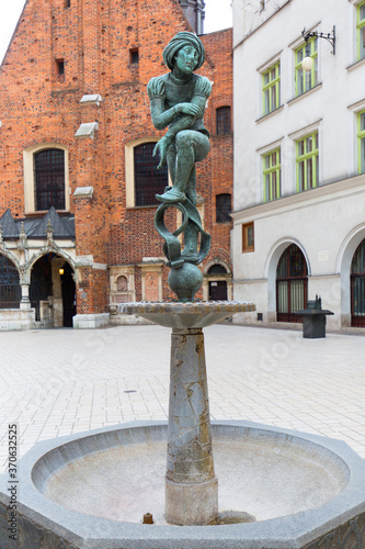 Fototapety, obrazy: Figurine student, a copy of the form from the altar of Veit Stoss, fountain in the square of St. Mary, Krakow, Poland