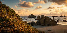 Beautiful Sunset Over Castle Rock Formation At Bandon Beach In Oregon.