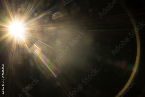 Photo Abstract Natural Sun flare on the black