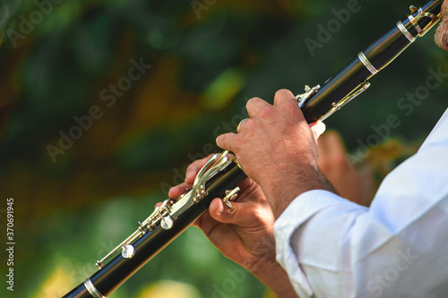 Detail of a street musician playing the clarinet Fototapete
