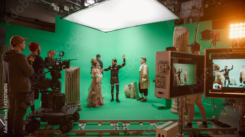 Stampa su Tela Film Studio Set: Shooting Green Screen Scene with Two Talented Actors Wearing Renaissance Clothes Talking, Director Finishes Scene, Celebrates Success, Embraces Actors