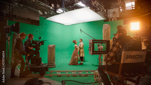 Obraz Film Studio Set: Shooting Green Screen Scene with Two Talented Actors Wearing Renaissance Clothes Talking, Embraces. Period Drama Movie Backstage - fototapety do salonu