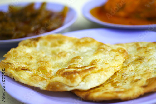 Photo Indian Cuisine - Roti Prata accompanied with various curry sauces