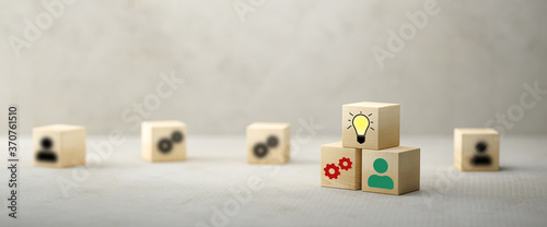 Fototapeta cubes showing a brainstorming session on concrete background obraz