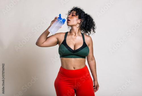 Obraz Plus size woman making sport and fitness - fototapety do salonu