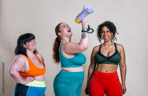 Plus size women making sport and fitness. Wallpaper Mural