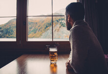 Man Drinking Beer In  His Mountain Cabin