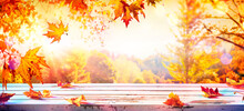 Autumn Table With Red And Yellow Leaves With Blurred Sunset Background