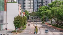 Traffic With Cars On A Street And Urban Scene In The Central District Of Singapore Aerial Timelapse. N Canal Road With Downtown Skyscrapers On A Background