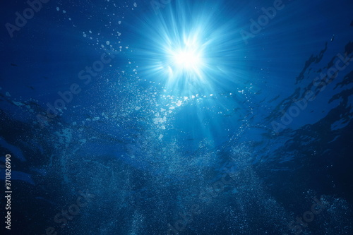 Sunlight underwater with air bubbles rising to water surface, natural scene, Mediterranean sea #370826990