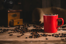 Cup Of Coffee Beans On Table