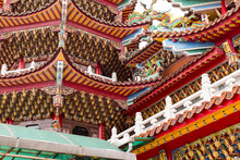 Low Angle Of Traditional Buddhist Temple With Curved Roof And Decorations Located In Taipei