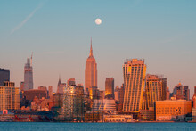 Amazing Skyline Of New York City With Contemporary Architecture Under Night Sky With Full Moon