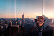 Tourist Binoculars Mounted On Observation Point Of High Building With Manhattan Cityscape At Sunset Time In Background