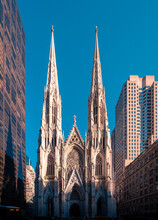 Low Angle Exterior Of Famous Neo-Gothic Styled Cathedral Of St Patrick Located On Manhattan In New York City Against Cloudless Blue Sky In Sunny Day