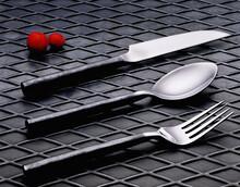 Metal Spoon Placed On Black Te...