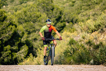 Man In Helmet Riding Mountain ...