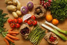 Top View Of Assorted Fresh Vegetables And Ripe Fruits Arranged On Wooden Table